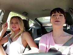 Two daring girls have some hot lesbian sex in the back of a car