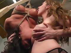 Lesbian BDSM woman in bondage tit suck breast suck smother