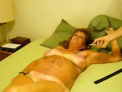 Busty brunette mature Bobbi is getting filmed and tortured
