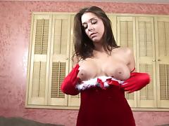Christmas beauty in sexy red satin gloves fondles her tits