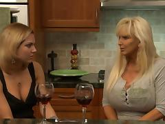 Mature big boobed lesbian seduces the hot girl next door