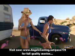 Sexy lesbian cowgirls undressing and licking tits and pussy