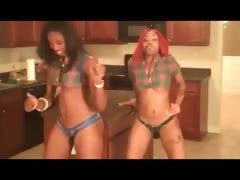 Two ebony babes dancing the pole