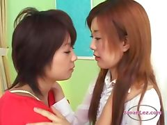 2 Asian Girls Kissing Passionately Sucking Tongues On The Bed