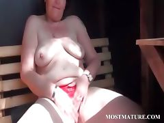 Mature babe rubs pussy with sexy undies