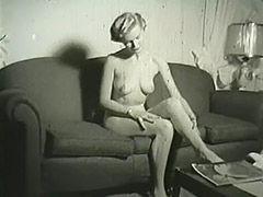 Blonde Undresses in Her Apartment 1950