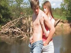 Young couple sex by the lake