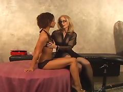 Izabella Star and Nina Hartley fuck each other with strap on