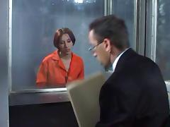 Female cop finger fucks the detainee