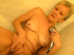 Sweet granny is playing in the shower