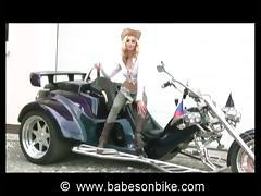 Cowgirl gets naked on bike