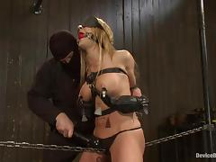 Amy gets blindfolded and bent over in the device